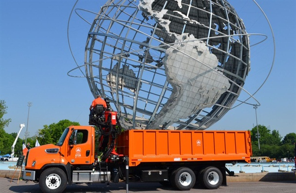 A Parks Department forestry log loader is pictured here in front of the Unisphere in Queens, New York. Photo courtesy of New York City.