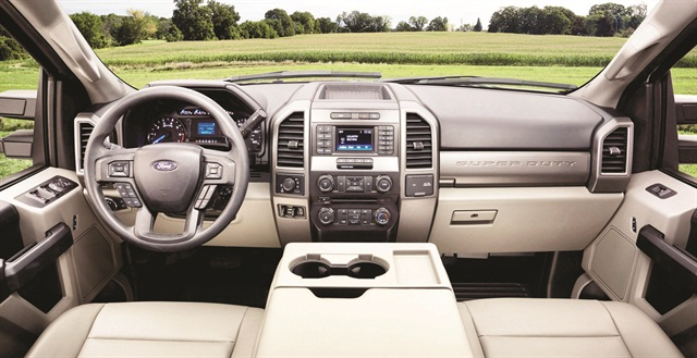 A new interior design includes a dual-compartment glove box and overhead console-mounted auxiliary switches to operate aftermarket equipment. Photo courtesy of Ford