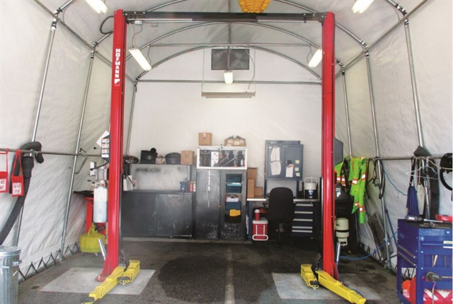 The satellite repair shop takes up about one and a half parking spaces, and the front is a vinyl door that can be closed. Photo courtesy of City of Abbotsford