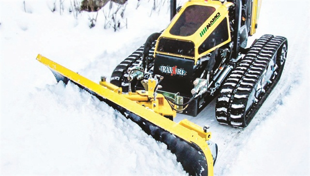 A snow blade can help operators clear snow on hilly terrain. Photo courtesy of Alamo