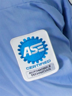 In addition to banners proclaiming ASE Blue Seal certification, technicians can wear patches on their uniforms to show their individual certification. Photo courtesy of town of ASE.