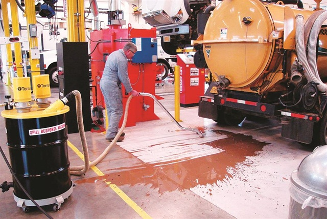 Technicians use a wet vacuum cleaner to clean up spills quicker and in a more enviornmentally friendly way. Photo courtesy of EWEB