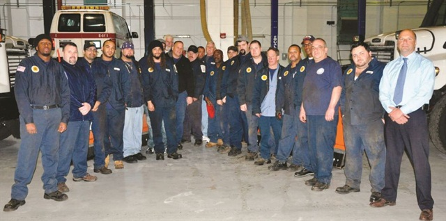 Pictured here are some of the City of Boston's 38 fleet staff members. Technicians at the City's fleet now collectively hold 70 ASE certifications, including six Master technician designations.