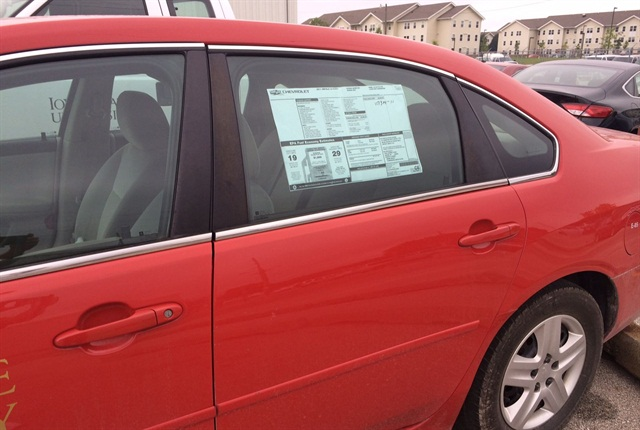 Vehicle information placed on windows gives potential buyers all the information they need about the vehicle at auction time.