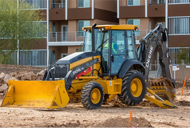 The 310SL HL backhoe loader can be used to load trucks, break blacktop, place pipes, dig trenches, and move materials. Photo courtesy of Deere