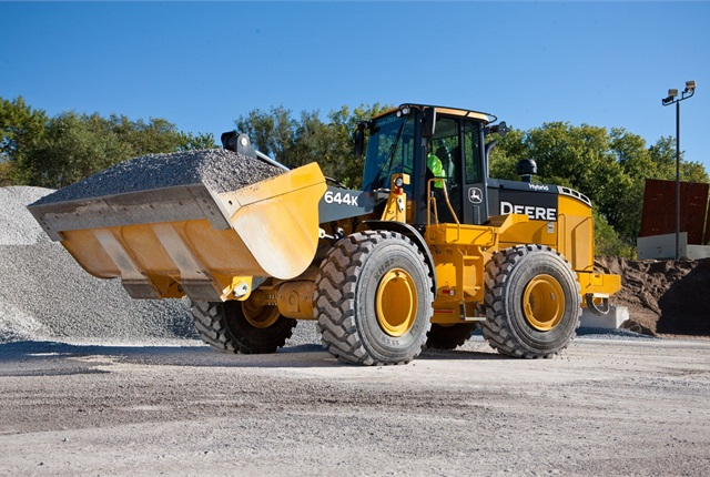 John Deere's 644K electric-hybrid wheel loader utilizes two sources of energy, diesel and electric, capturing regenerated energy as it is being created and using it to power the machine. Photo courtesy of John Deere.