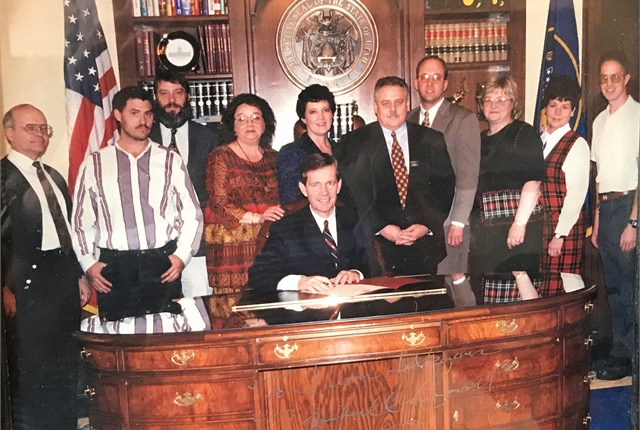 Saltzgiver worked at the State of Utah for 11 years, Pictured: the fleet team with then-Governor Steve Leavitt. Photo courtesy of Steven Saltzgiver