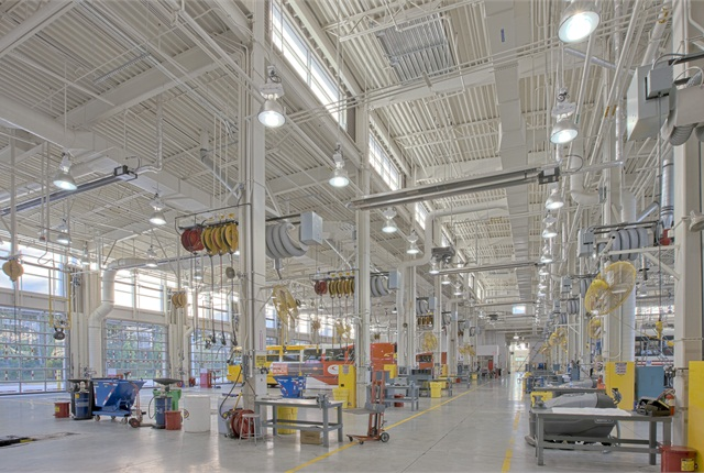 Natural lighting sources and light-reflective floor and wall surfaces are some sustainable design features that help improve lighting at a maintenance facility. Photo courtesy of MDG