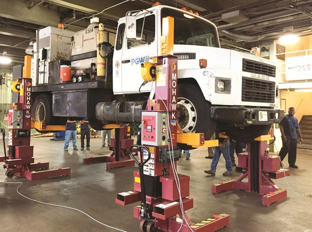 A hydraulically operated truck operates more than twice as fast as a screw-type mobile lift, according to Mohawk Lifts. Photo courtesy of Mohawk Lifts