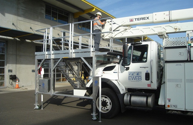 EWEB's scaffolding device brings the technician up to the work area and allows him to work on a steady surface