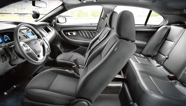 The front seats of the Ford Police Interceptor sedan are upholstered with heavy-duty cloth and designed to provide lumbar support for officers on long shifts. Photo courtesy of Ford