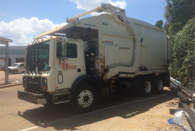 Sam Houston State University's new front-loading solid waste trucks can accommodate larger volumes of waste and reduce personnel injury. Photo courtesy of Sam Houston State University