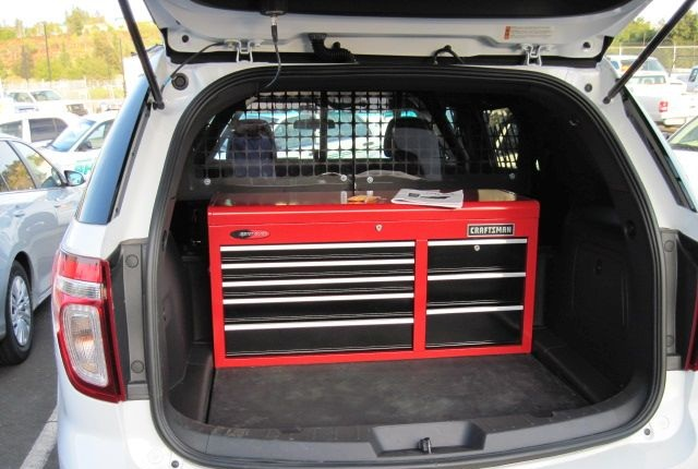 Technicians worked on a toolbox placement that would allow access to the spare tire and other equipment.