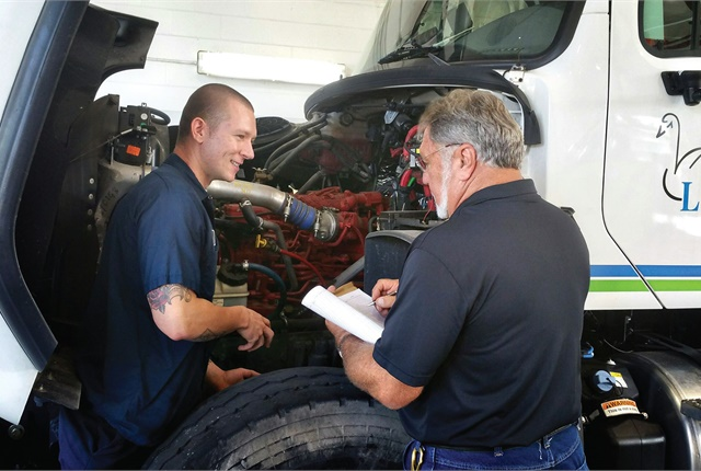 City of Lakeland, Fla., Fleet Maintenance Supervisor Phil Chaffin (right) performs a task certification on Anthony Majkiewicz (left) as part of his assessment to be promoted to mechanic 3. Photo courtesy of City of Lakeland