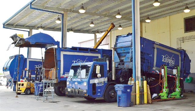 One of the fleet's challenges will be keeping up with an expanding compressed natural gas (CNG) fleet. Vehicles are now repaired outside under an awning (pictured). Photo: Thi Dao