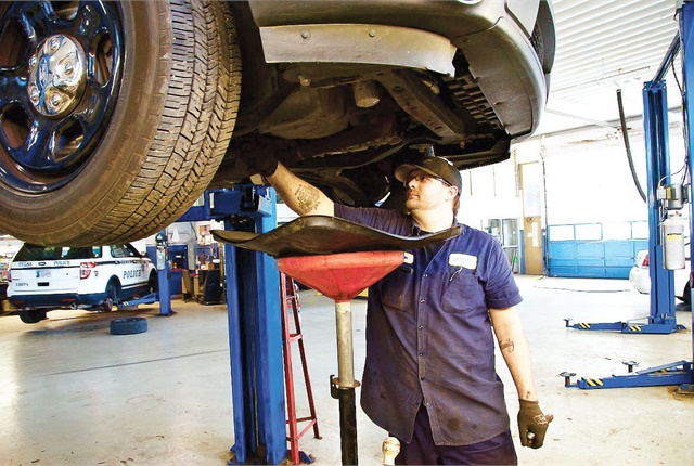 The City of Tulsa, Okla., handles most of its own warranty work for Ford vehicles, but outsources these jobs if technicians are too busy. Pictured is Technician Sean Hawkins. Photo courtesy of City of Tulsa