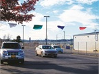 "Vehicle return lanes have color-coded flags, pictured here during a ""lean event."" Vehicle dispatch packets are color coded so customers know in which lane to return the vehicle, which speeds vehicle return and detailing. Photo courtesy of the State of Oregon."