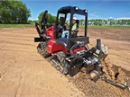 The Toro RT1200 riding trencher, shown here without the cab, is geared for mid- to long-range trenching applications in utility work. Photo courtesy of Toro