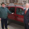 Bill Roberts (left), associate director of parking and transportation for the University of Minnesota poses with University President Bob Bruininks. Since 2002, the university has trained 4,000 drivers of its 15-passenger vans via a two-hour mandatory training class.
