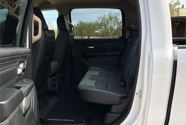 The second row includes slide reclining seats to eight degrees, with a flat load floor with integrated RamBins and tie-down rings. There is expandable under-seat storage.