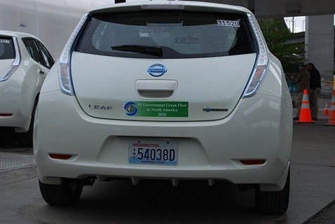 "The back of a Nissan Leaf shows the decal: ""#1 Government Green Fleet in North America - 2010"""