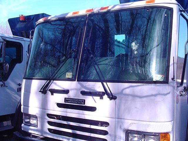 Eighteen windshields in 15 trash trucks were damaged.
