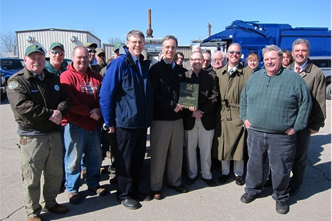 County Executive Joe Parisi, center, holding plaque, made the announcement about the grant on March 8 at the county's Rodefeld Landfill. Photo via Dane County's website.