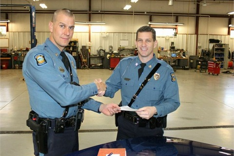 Trooper Michael Winner (left) accepts the keys for the last Ford CVPI issued for patrol from Capt. Scott Harrington. Photo courtesy KHP.