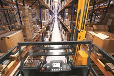 The system uses transponder RFID technology to control narrow-aisle lift trucks within the aisles of a warehouse. Photo by MCFA.