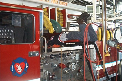 Lane inspects one of Loveland's firefighting equipment assets.