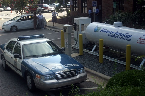 One of the dual-fuel Ford Crown Victorias next to the newly installed fueling station.