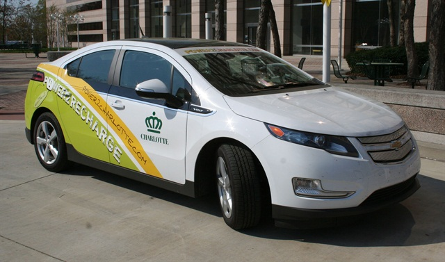 The City of Charlotte's electric vehicle fleet, including this Volt, has been decorated with graphics advertising the Power2 Charlotte campaign, the education component of the City's energy initiatives. Photo courtesy of the City of Charlotte.
