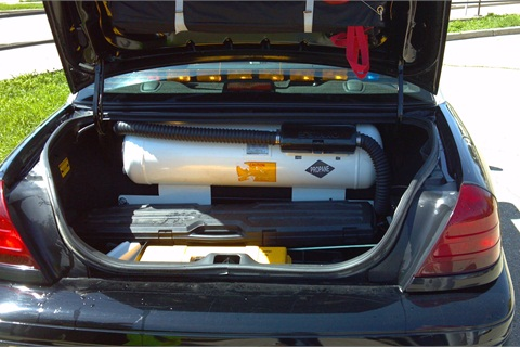 A propane tank is installedin the trunk of the Crown Victoria.