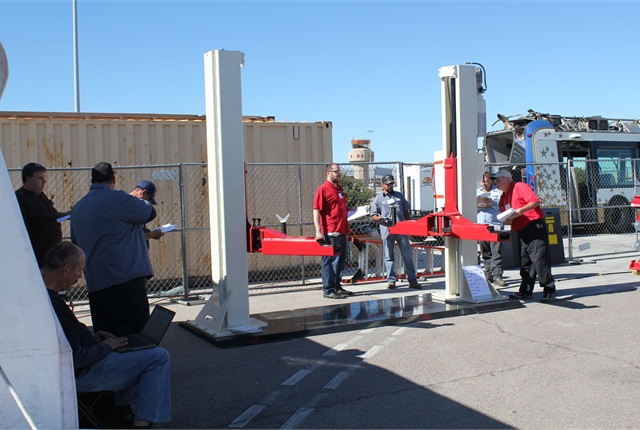 ALI Lift Inspector Certification program candidates inspect a heavy-duty two-post lift at the Regional Transportation Center in Las Vegas as part of the Five Days to Victory accelerated certification program organized by several ALI member manufacturers in November. Photo courtesy of ALI