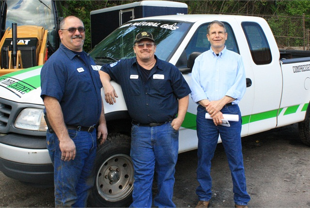 Rob Martin, Darryl Rice, and Kevin Haughinberry stand next to one of the City's CNG-powered pickups. Photo courtesy City of Asheville.