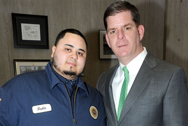 Pablo Guerrero, former intern from Ben Franklin Technical Insittute, is pictured here with Boston Mayor Martin Walsh. Guerrero is now a full-time Boston fleet technician. Photo courtesy of City of Boston
