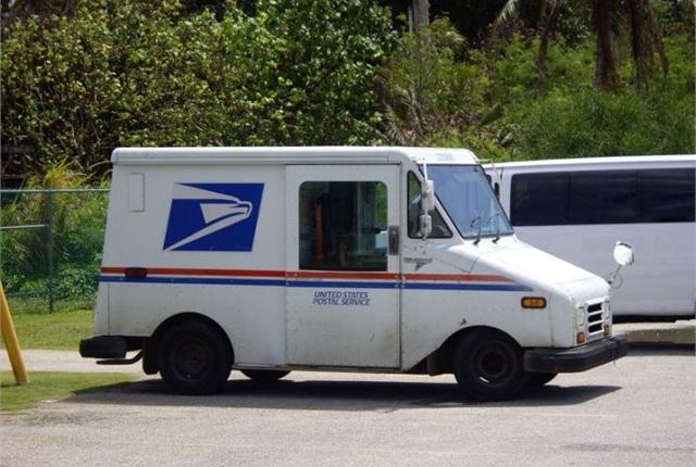 Photo of USPS vehicle via Wikimedia.