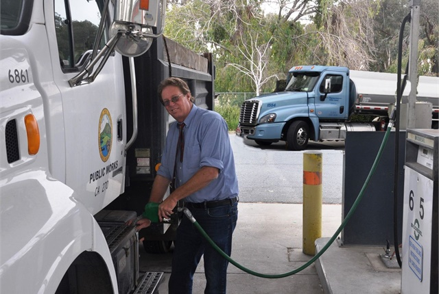 Contra Costa County Materials and Recycling Manager Stan Burton is pictured here refueling a vehicle. Photo courtesy of Contra Costa County