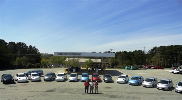 Fleet management staff stand with the 16 Nissan Leafs. Photo courtesy of Cobb County.