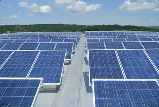 This example of a solar array shows how the array will be mounted on the roof of the fleet storage building.