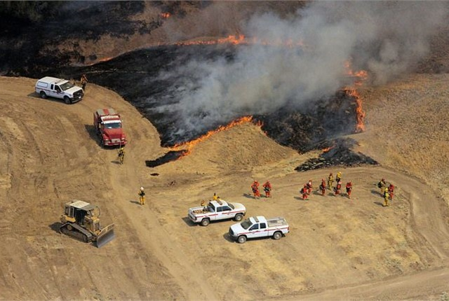 Fire equipment in action via California National Guard/Flickr