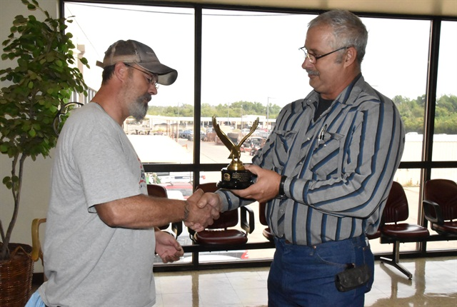 Edmond Yelle, Jr, automotive mechanic, City of Wichita Falls, Texas, (left) accepts his Professional Fleet Manager of the Year award from the city's fleet supervisor, Wade Looney. Photo courtesy of RMFMA.