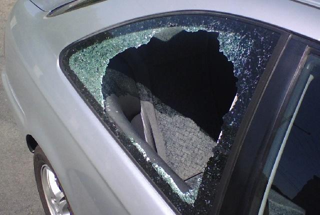 Stock photo of a broken car window via Kafziel/Wikimedia