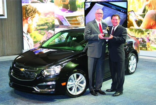 Bob Brown Jr., Great Lakes sales manager for Automotive Fleet (right), presented the 2014 Fleet Car of the Year Award to Ed Peper, U.S. vice president for fleet and commercial sales for GM. Photo courtesy of Robert Brown.