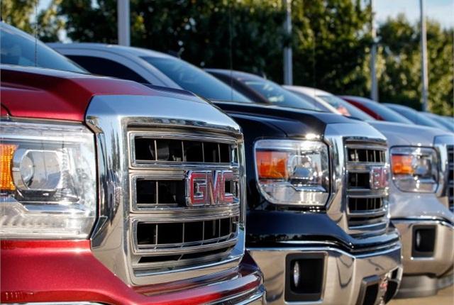 Photo of GMC trucks on dealer lot courtesy of GM.