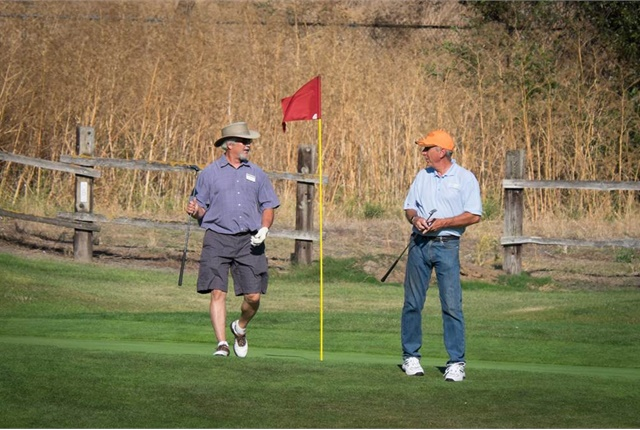 Tom Gannon, retired fleet manager from Alameda County Public Works, and Rodney Michaelson from cleanfleets.net play a round of golf. Photo by Tom Fung.