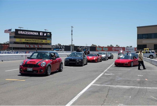 Numerous vehicles were available to take attendees around the track. Photo by Tom Fung