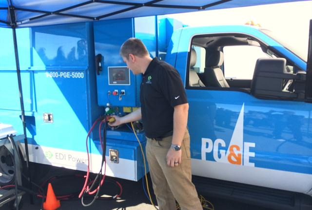 Kaufman demonstrates the Altec systems electric powered boom on the EDI/PG&E Class-5 Trouble Truck.