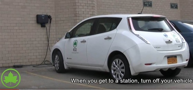 This screencapture of an instructional video shows how to charge an electric vehicle.