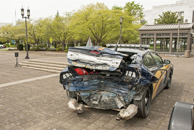 This OSP car was pulled to the side of the road with lights and flares, yet was hit by a distracted driver. Photo via Flickr/Oregon DOT